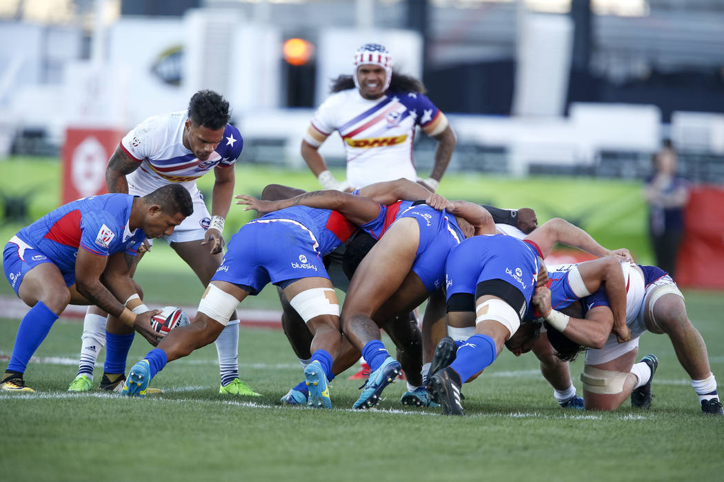 Samoa, blue team, and United States scrum during day one of the USA Sevens Rugby tournament at Sam Boyd Stadium in Las Vegas on Friday, March 2, 2018. Richard Brian Las Vegas Review-Journal @vegas ...