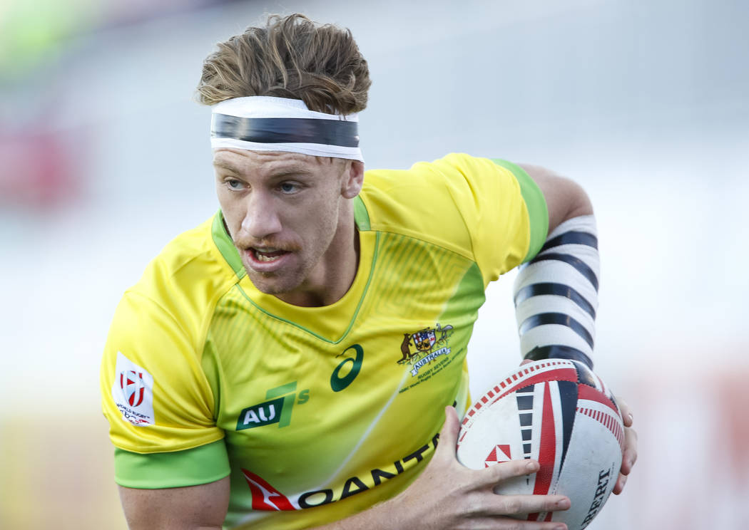 Ben O'Donnell of Australia runs the ball against Spain during day one of the USA Sevens Rugby tournament at Sam Boyd Stadium in Las Vegas on Friday, March 2, 2018. Richard Brian Las Vegas Review-J ...