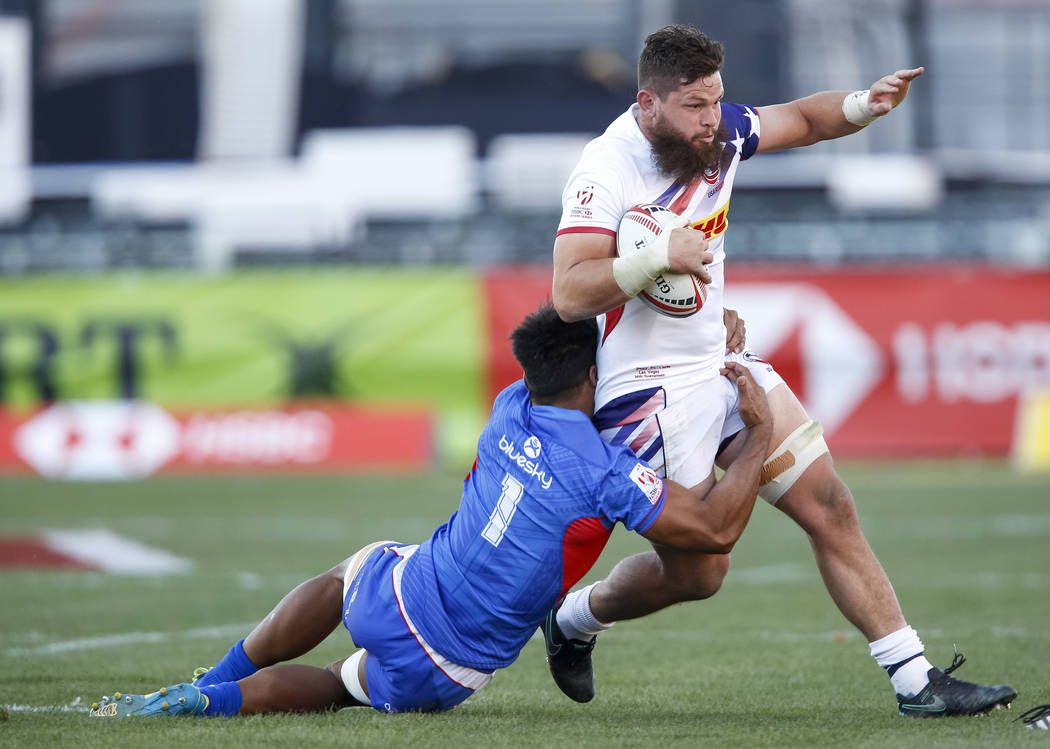 Carlin Isles of Samoa tackles Danny Barrett of the US during day one of the USA Sevens Rugby tournament at Sam Boyd Stadium in Las Vegas on Friday, March 2, 2018. Richard Brian Las Vegas Review-Jo ...