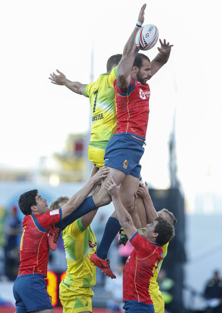 Tim Anstee of Australia (7) and Inaki Villanueva of Spain vie for lineout during day one of the USA Sevens Rugby tournament at Sam Boyd Stadium in Las Vegas on Friday, March 2, 2018. Richard Brian ...