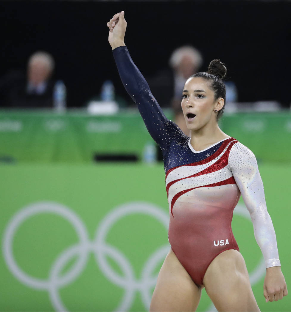 United States' Aly Raisman celebrates after her performance on the floor during the artistic gymnastics women's team final at the 2016 Summer Olympics in Rio de Janeiro, Brazil on Aug. 9, 2016. (C ...
