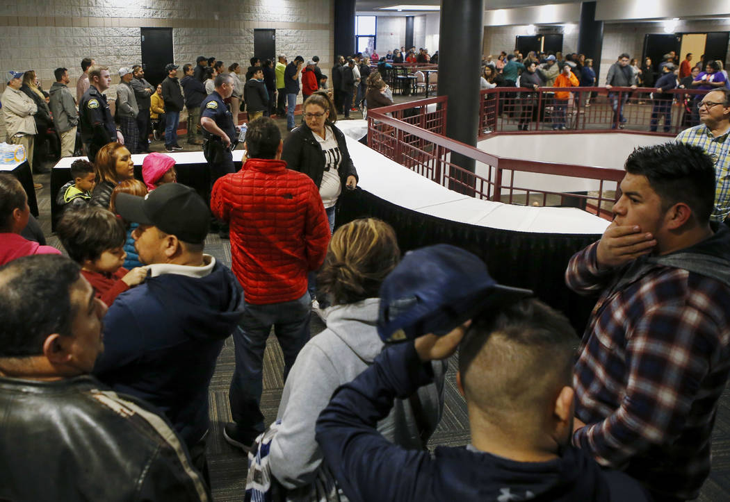 People lineup inside the Dalton Convention Center to pick up their children on Wednesday, Feb. 28, 2018, in Dalton, Ga. Students from Dalton High School were evacuated to the convention center aft ...
