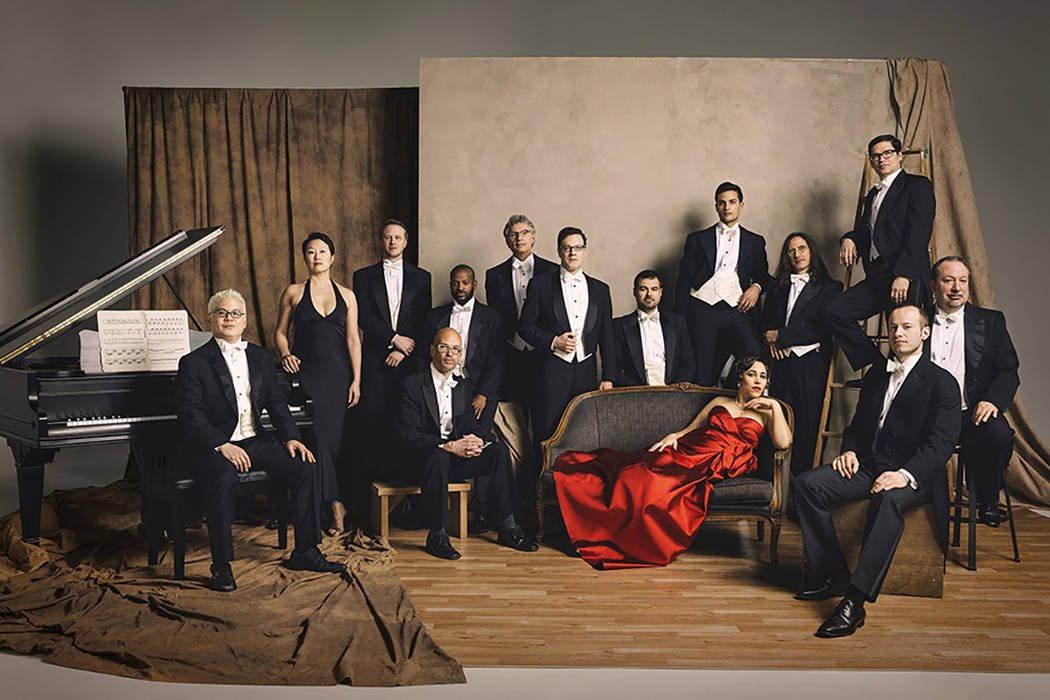 The Pink Martini lineup, with Thomas Lauderdale at far left and China Forbes in red dress. (Pink Martini)
