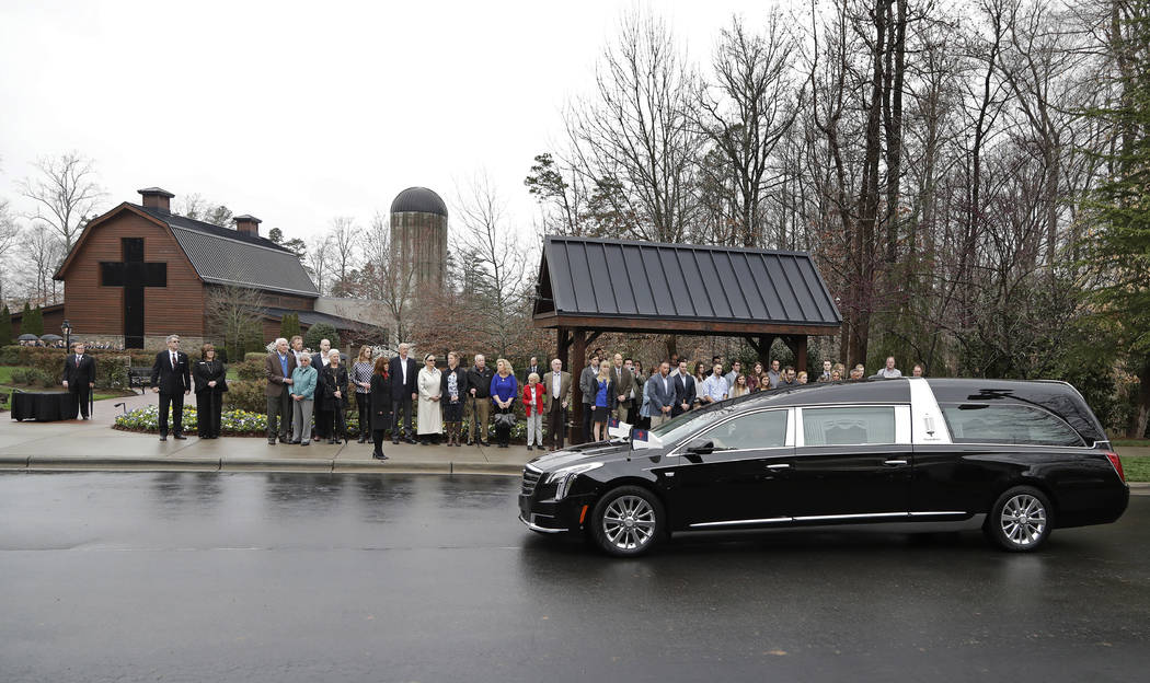 Family members look on as the hearse carrying the body of the Rev. Billy Graham returns to the Billy Graham Library in Charlotte, N.C., Thursday, March 1, 2018. (Chuck Burton/AP)
