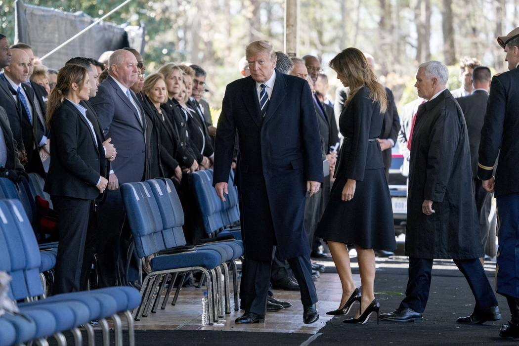 President Donald Trump, first lady Melania Trump, Vice President Mike Pence arrive at the funeral of Reverend Billy Graham in Charlotte, N.C., Friday, March 2, 2018. (AP Photo/Andrew Harnik)