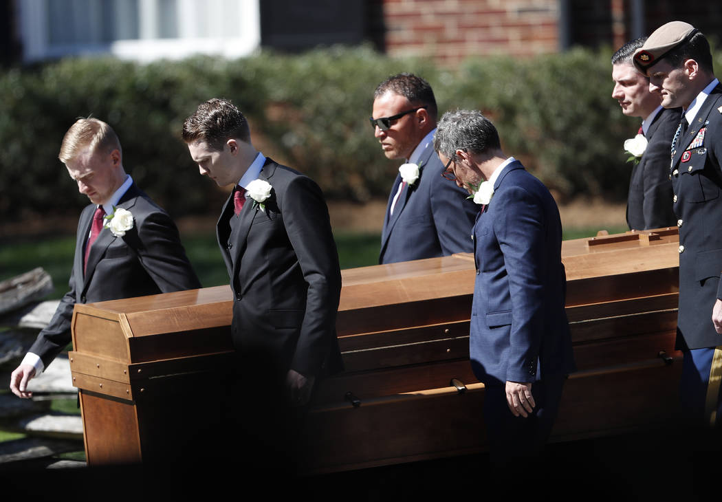 The casket of The Rev. Billy Graham is moved during a funeral service at the Billy Graham Library for the Rev. Billy Graham, who died last week at age 99, Friday, March 2, 2018, in Charlotte, N.C. ...