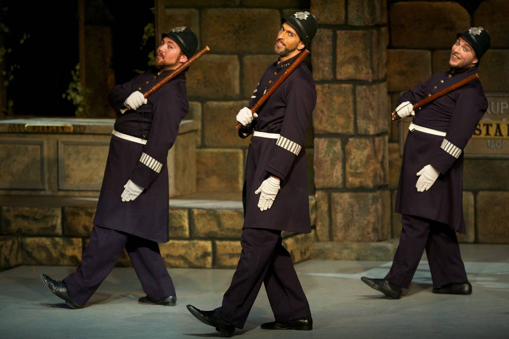 "Constables lament ""A Policeman's Lot Is Not a Happy One"" in New York Gilbert & Sullivan Players' ""The Pirates of Penzance,"" which plays UNLV March 9."