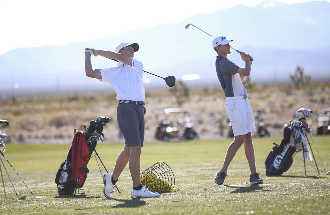 Arbor View's Hazen Newman, left, and Preston Harris at the driving range during practice at the Paiute Golf Resort in Las Vegas on Tuesday, March 6, 2018. Chase Stevens Las Vegas Review-Journal @c ...