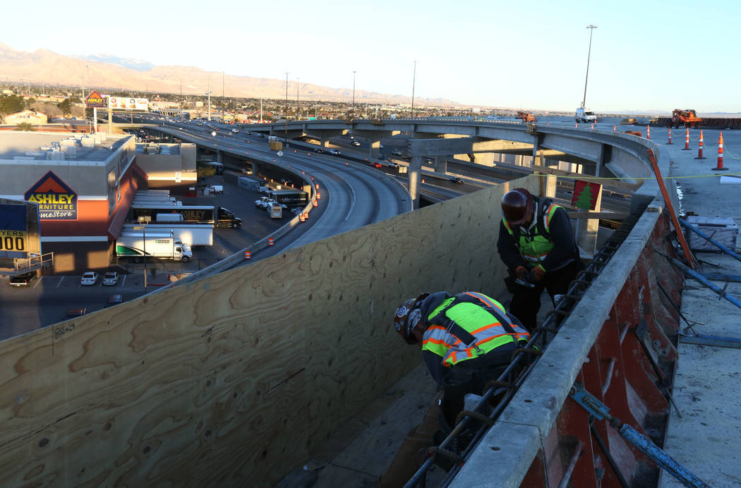 Construction workers on the HOV flyover that connects Interstate 15 North and South on Monday, March 5, 2018, during an initial round of ramp and lane closures around the Spaghetti Bowl interchang ...