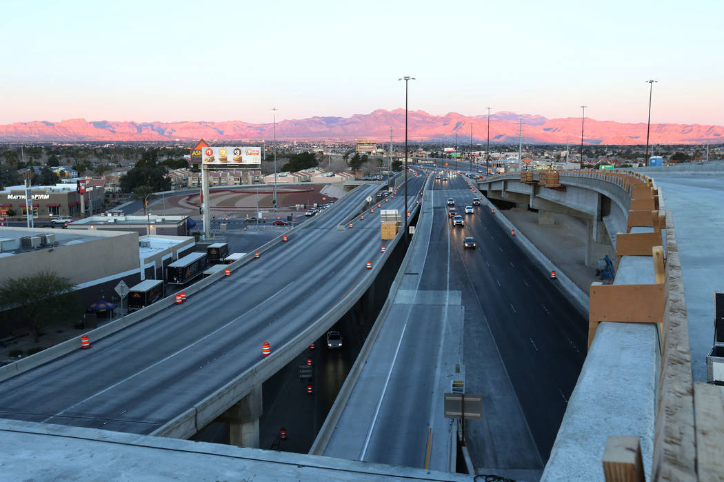 Smooth traffic flow is seen on U.S. Highway 95, right, during an initial round of ramp and lane closures connecting Interstate 15 South, left, around the Spaghetti Bowl interchange on Monday, Marc ...