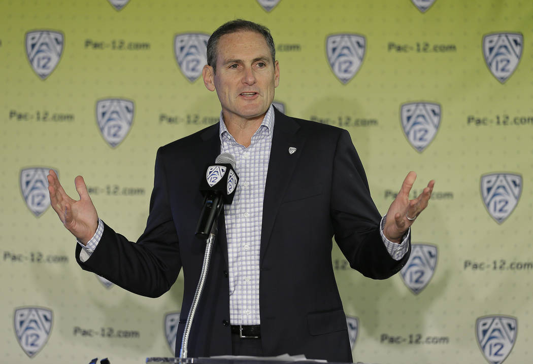 Pac-12 Commissioner Larry Scott speaks during the Pac-12's NCAA college basketball media day, Thursday, Oct. 12, 2017, in San Francisco. (AP Photo/Eric Risberg)