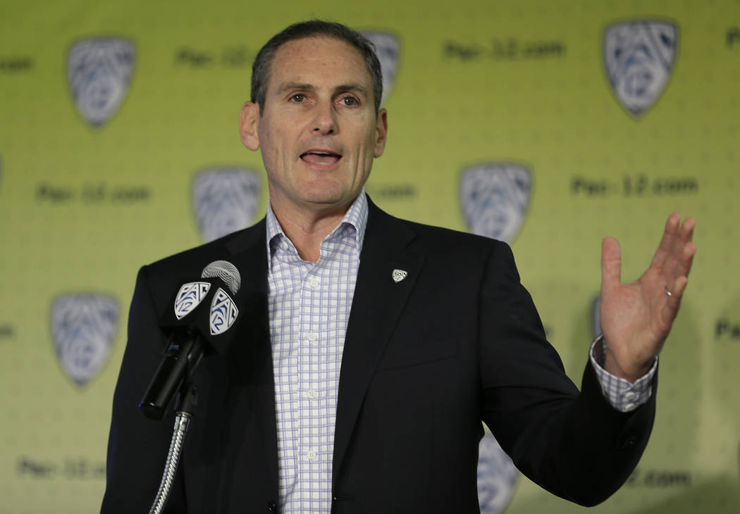 Commissioner Larry Scott gestures while speaking about the formation of a task force on recruitment issues during NCAA college basketball Pac-12 media day Thursday, Oct. 12, 2017, in San Francisco ...