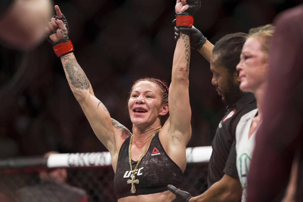 """Cris """"Cyborg"""" Justino is declared the winner against Holly Holm in the UFC 219 women's featherweight title bout at T-Mobile Arena in Las Vegas, Saturday, Dec. 30, 2017. Justino wo ..."""