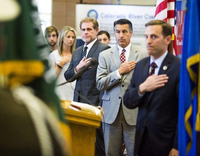 Chief Justice Ron Parraguirre, left, Gov. Brian Sandoval, and Attorney General Adam Laxalt stand during the presentation of the colors at the reception to commemorate the 800th anniversary of the  ...