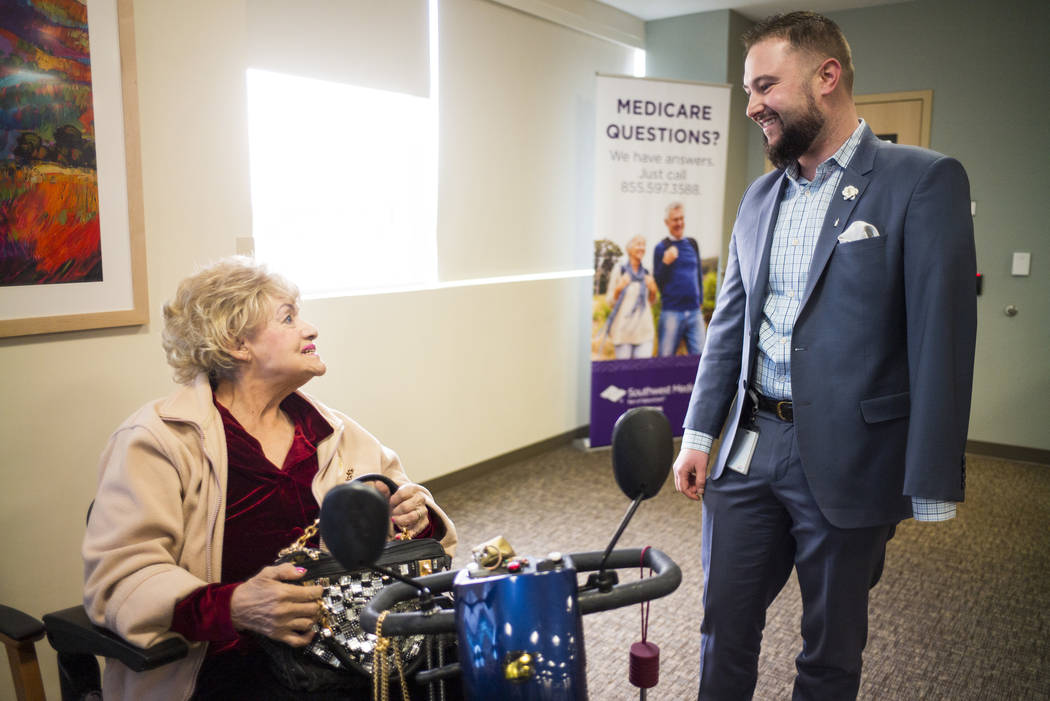 Chris Singer, vice president of Patient Experience at OptumCare, which oversees Southwest Medical, talks with Kathryn Ross, 84, at the Oakey Healthcare Center in Las Vegas on Wednesday, March 7, 2 ...