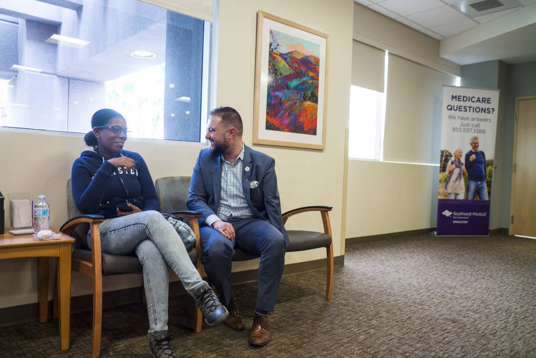 Chris Singer, vice president of Patient Experience at OptumCare, which oversees Southwest Medical, talks to April J., 34, who visited the Oakey Healthcare Center with her mother, in Las Vegas on W ...