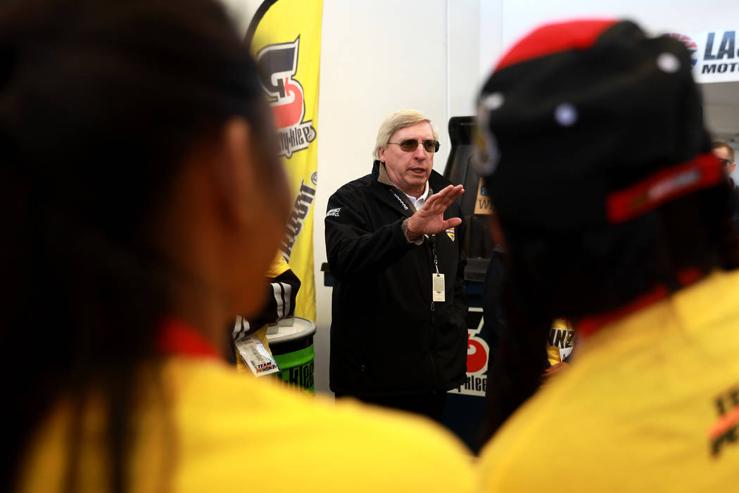 Drew Patey, director of Motor Sports, talks to students from Hyde Park Middle School Academy of Science and Mathematics about recycling oil during a tour at the Las Vegas Motor Speedway in Las Veg ...