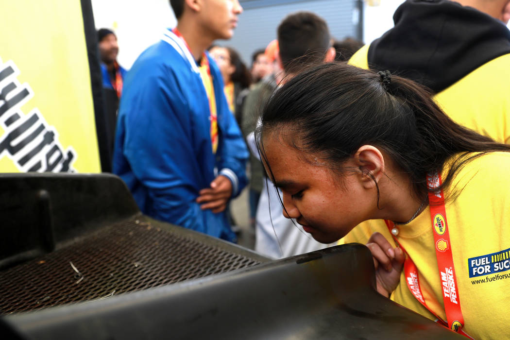 Syrelle Manansala, 14, smells recycled oil during a tour at the Las Vegas Motor Speedway in Las Vegas on Sunday, March 4, 2018. The 50 students won a contest to design, build and race a model race ...