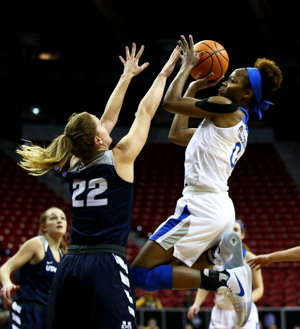 Air Force Falcons' Dee Bennett (0) shoots against Utah State Aggies' Rachel Brewster (22) during the Mountain West Conference tournament at the Thomas and Mack Center in Las Vegas on Monday, March ...