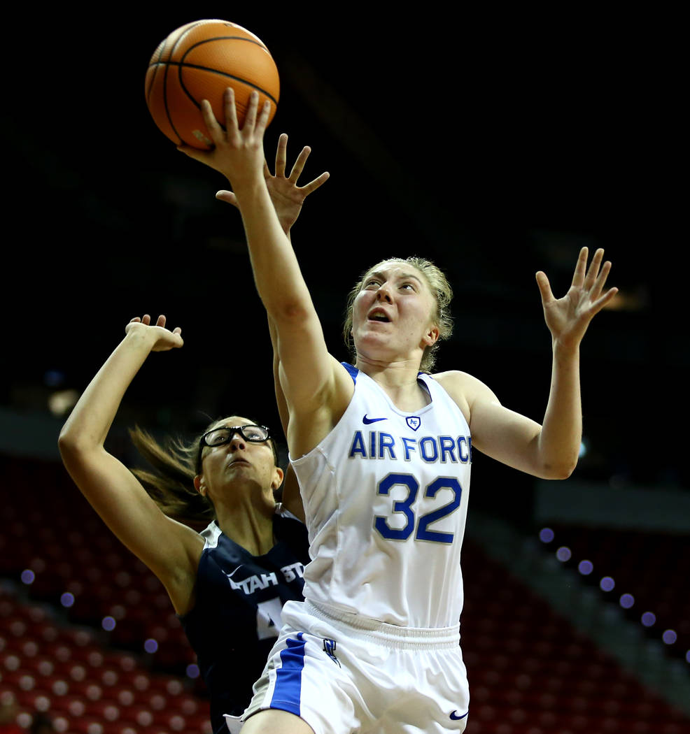 Air Force Falcons' Kaelin Immel (32) reaches for the ball during the Mountain West Conference tournament at the Thomas and Mack Center in Las Vegas on Monday, March 5, 2018. Andrea Cornejo Las Veg ...