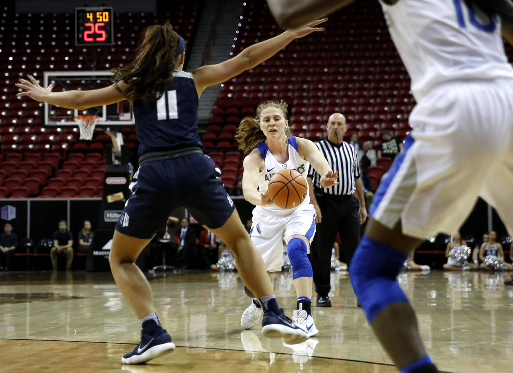 Air Force Falcons' Emily Conroe (13) passes the ball during the Mountain West Conference tournament against the Utah State Aggies at the Thomas and Mack Center in Las Vegas on Monday, March 5, 201 ...