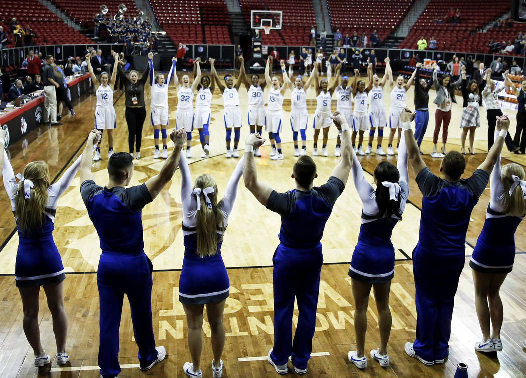 The Air Force Falcons women's basketball team celebrates after beating the Utah State Aggies during the Mountain West Conference tournament at the Thomas and Mack Center in Las Vegas on Monday, Ma ...