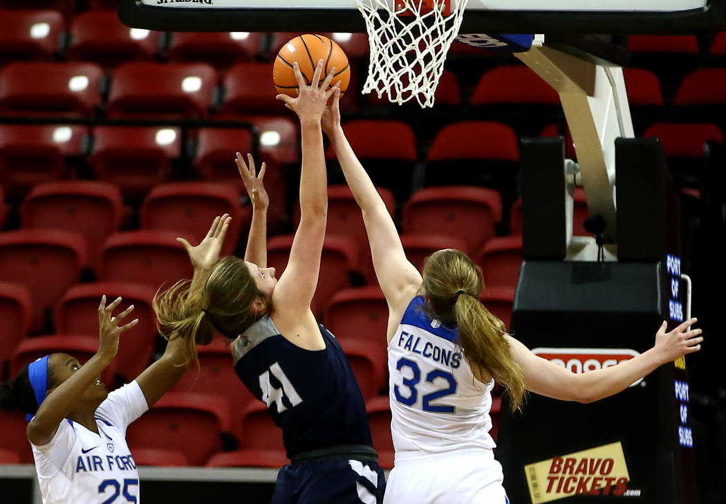 Utah State Aggies' Taylor Franson (41) reaches for the ball against Air Force Falcons' Kaelin Immel (32) during the Mountain West Conference tournament at the Thomas and Mack Center in Las Vegas o ...