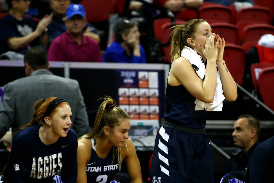 The Utah State Aggies women's basketball team cheers during the Mountain West Conference tournament at the Thomas and Mack Center in Las Vegas on Monday, March 5, 2018. Andrea Cornejo Las Vegas Re ...