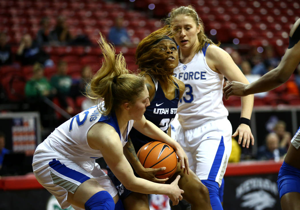 Utah State Aggies' Victoria Price (21) struggles for the ball against the Air Force Falcons during the Mountain West Conference tournament at the Thomas and Mack Center in Las Vegas on Monday, Mar ...