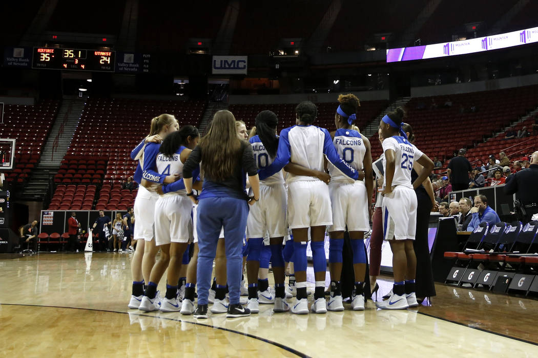 The Air Force Falcons girls basketball team gathers for a huddle during the Mountain West Conference tournament at the Thomas and Mack Center in Las Vegas on Monday, March 5, 2018. Andrea Cornejo  ...