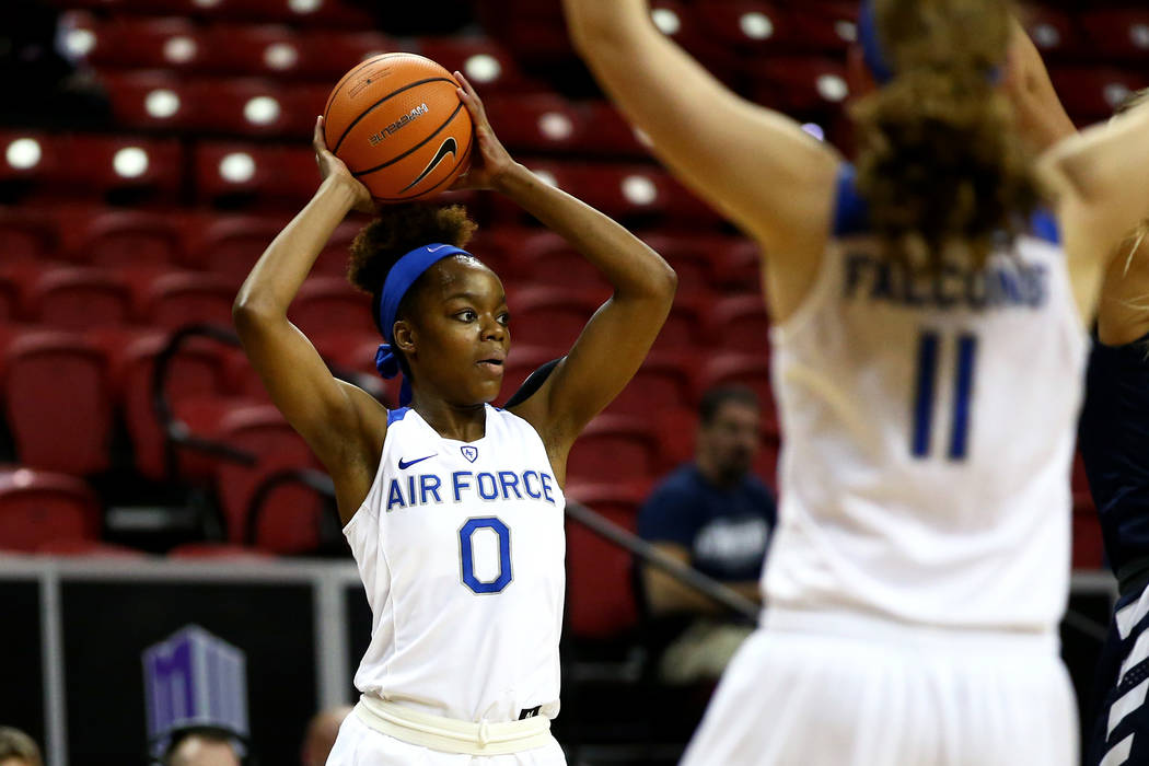 Air Force Falcons' Dee Bennett (0) tries to pass the ball past the Utah State Aggies during the Mountain West Conference tournament at the Thomas and Mack Center in Las Vegas on Monday, March 5, 2 ...