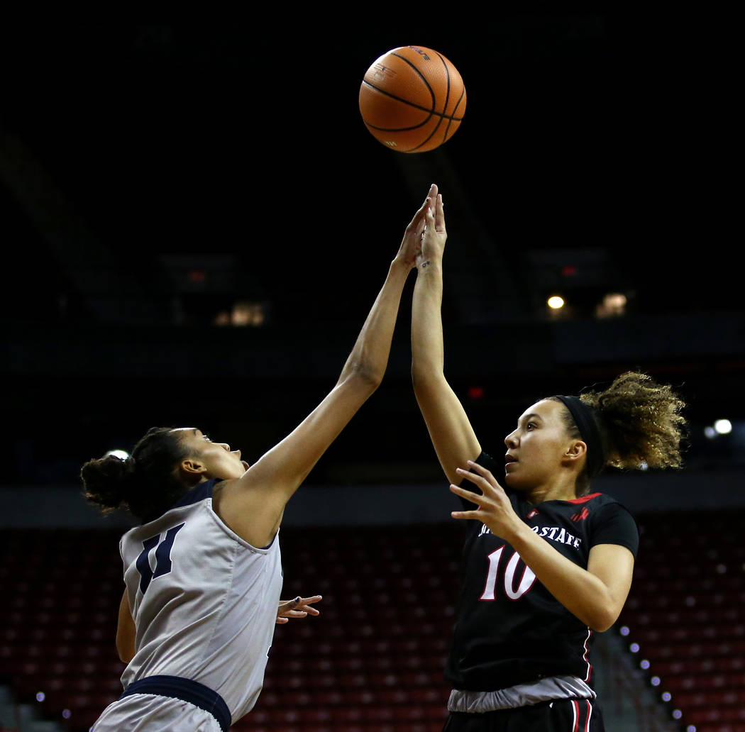 Nevada Wolf Pack's Terae Briggs (11) and San Diego State Aztecs' NajŽ Murray (10) reach for the ball during the Mountain West Conference tournament at the Thomas and Mack Center in Las Vegas on M ...