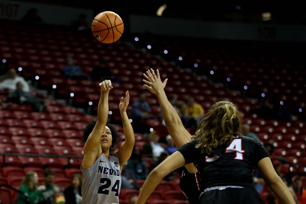 Nevada Wolf Pack's Camariah King (24) shoots the ball against the San Diego State Aztecs during the Mountain West Conference tournament at the Thomas and Mack Center in Las Vegas on Monday, March  ...