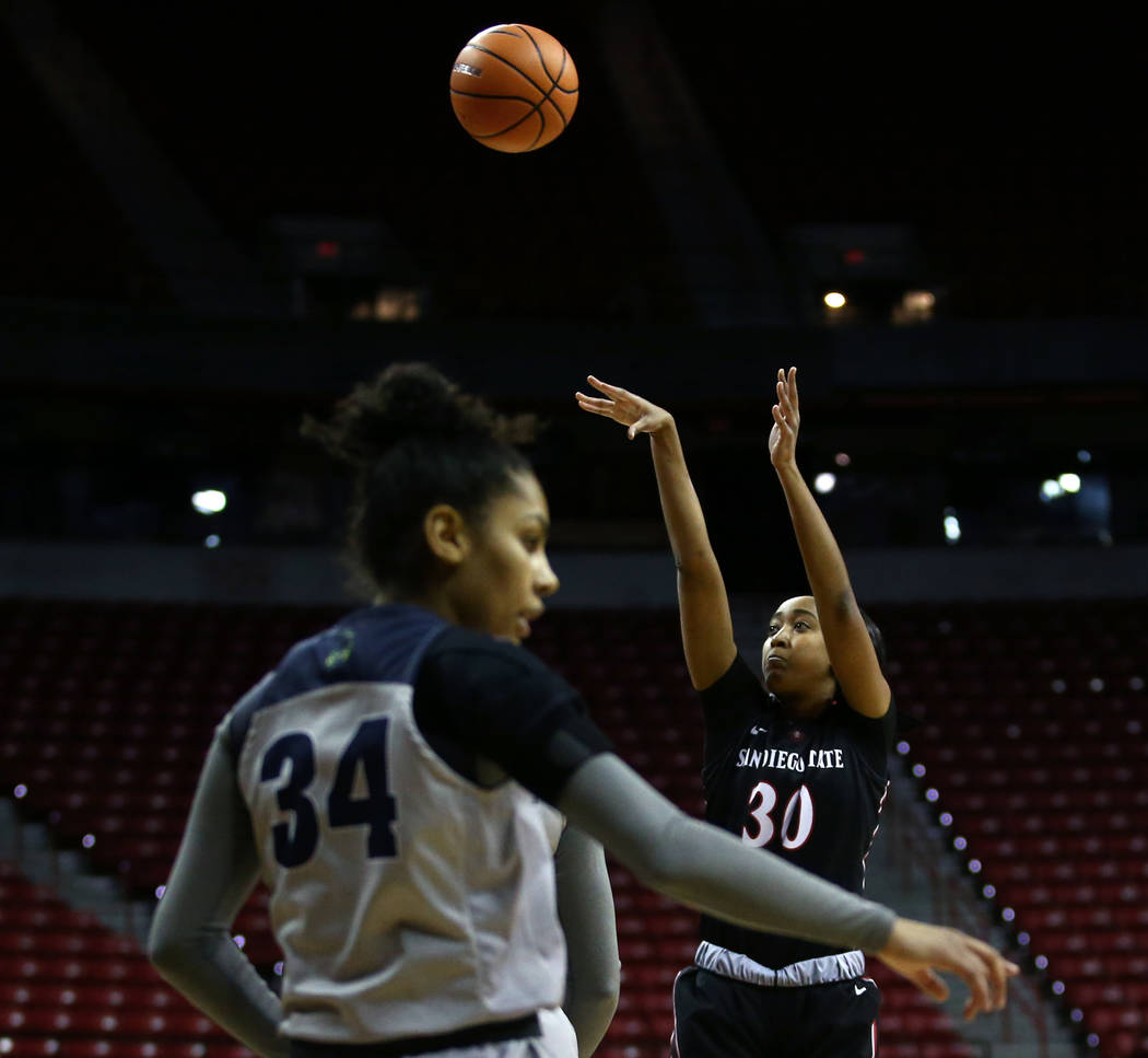 San Diego State Aztecs' Cheyenne Greenhouse (30) shoots the ball against Nevada Wolf Pack's Jade Redmon (34) during the Mountain West Conference tournament at the Thomas and Mack Center in Las Veg ...