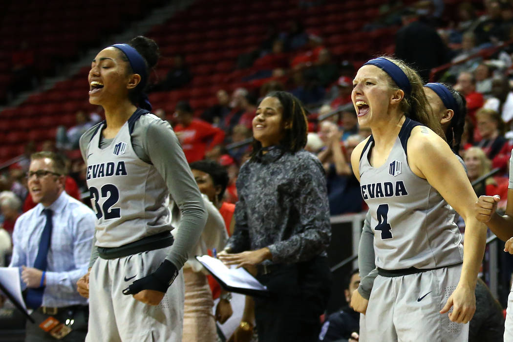 Nevada Wolf Pack women's basketball team reacts after a play against the San Diego State Aztecs during the Mountain West Conference tournament at the Thomas and Mack Center in Las Vegas on Monday, ...