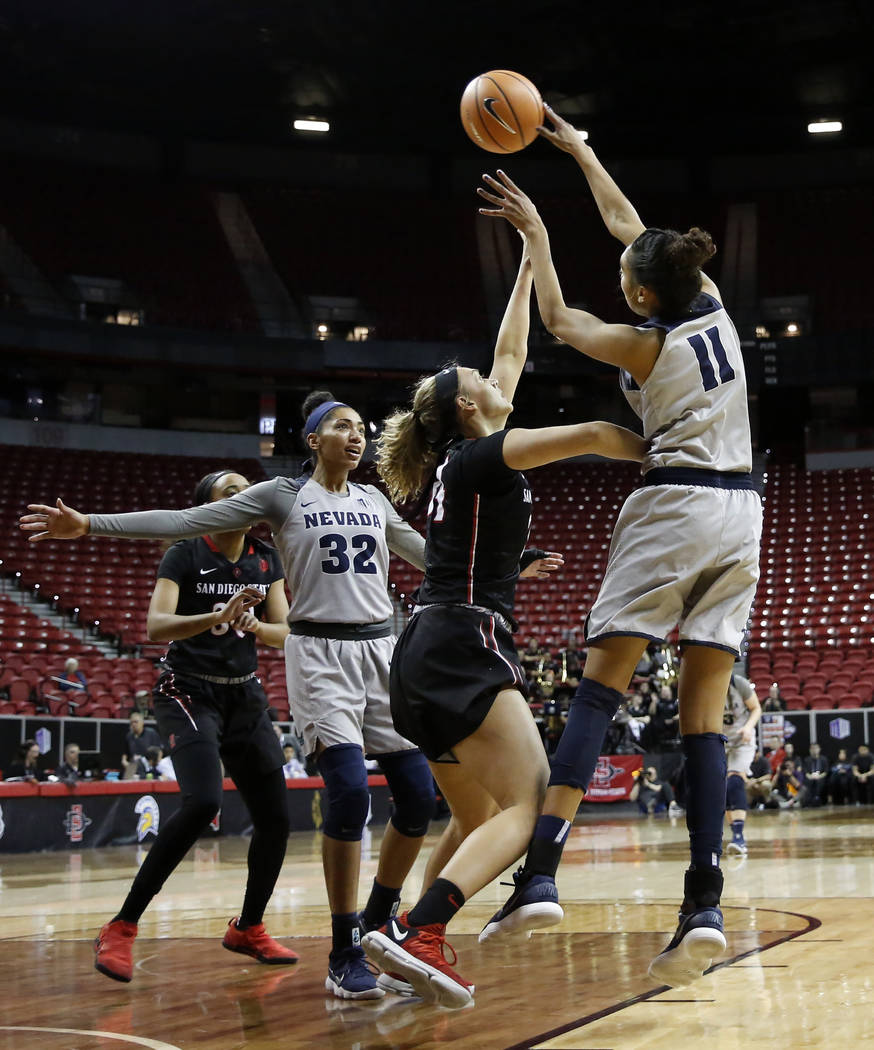 Nevada Wolf Pack's Terae Briggs (11) reaches for the ball against the San Diego State Aztecs during the Mountain West Conference tournament at the Thomas and Mack Center in Las Vegas on Monday, Ma ...
