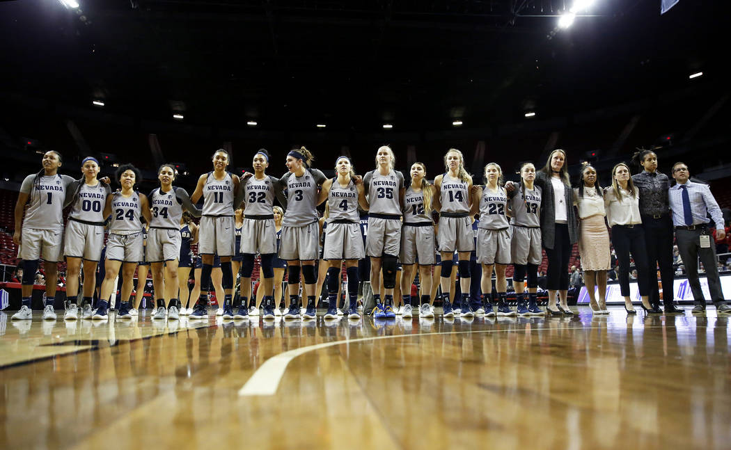 Nevada Wolf Pack women's basketball team celebrates after beating the San Diego Aztecs during the Mountain West Conference tournament at the Thomas and Mack Center in Las Vegas on Monday, March 5, ...