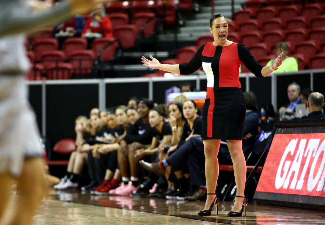 San Diego State Aztecs head coach Stacie Terry directs her team against the Nevada Wolf Pack during the Mountain West Conference tournament at the Thomas and Mack Center in Las Vegas on Monday, Ma ...