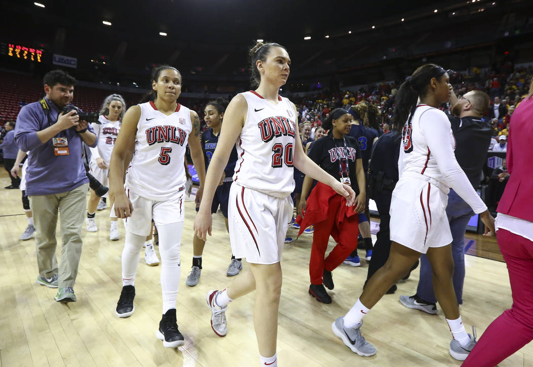 UNLV Lady Rebels players leave the court after losing to the UNR Wolf Pack in double overtime in a Mountain West tournament quarterfinal game at the Thomas & Mack Center in Las Vegas on Tuesda ...