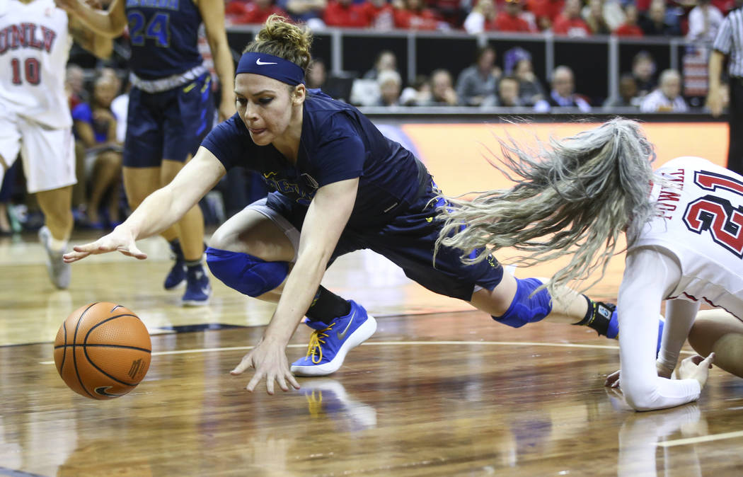 UNR Wolf Pack forward Teige Zeller (3) goes after a loose ball past UNLV Lady Rebels forward/center Katie Powell (21) during the first half of a basketball game in the Mountain West tournament qua ...