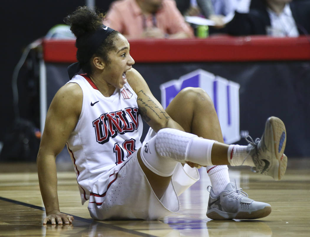 UNLV Lady Rebels guard Nikki Wheatley (10) reacts after an injury during overtime in a basketball game against the UNR Wolf Pack in the Mountain West tournament quarterfinals at the Thomas & M ...