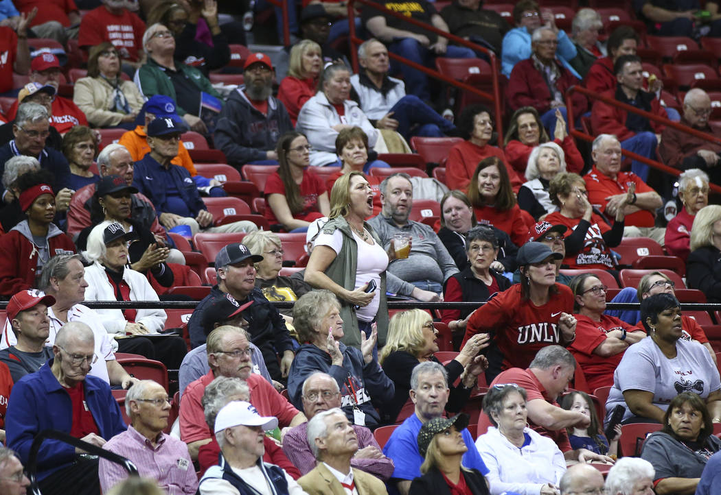 UNLV fans cheer as the team plays the UNR Wolf Pack during the first half of a basketball game in the Mountain West tournament quarterfinals at the Thomas & Mack Center in Las Vegas on Tuesday ...