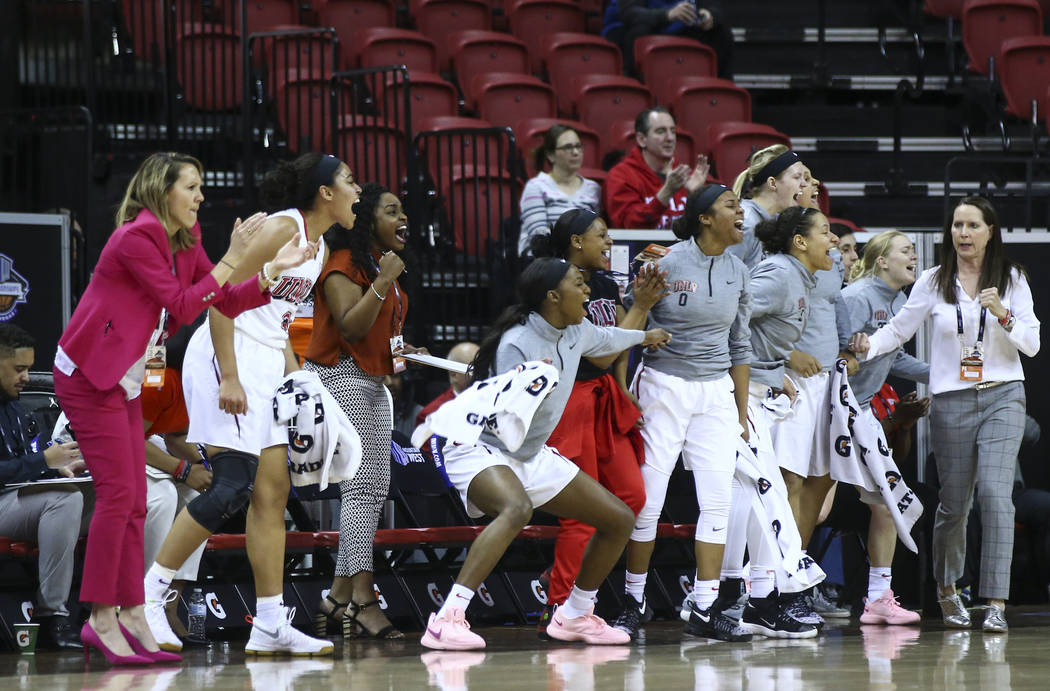 UNLV Lady Rebels players celebrate as the team plays the UNR Wolf Pack during the first half of a basketball game in the Mountain West tournament quarterfinals at the Thomas & Mack Center in L ...