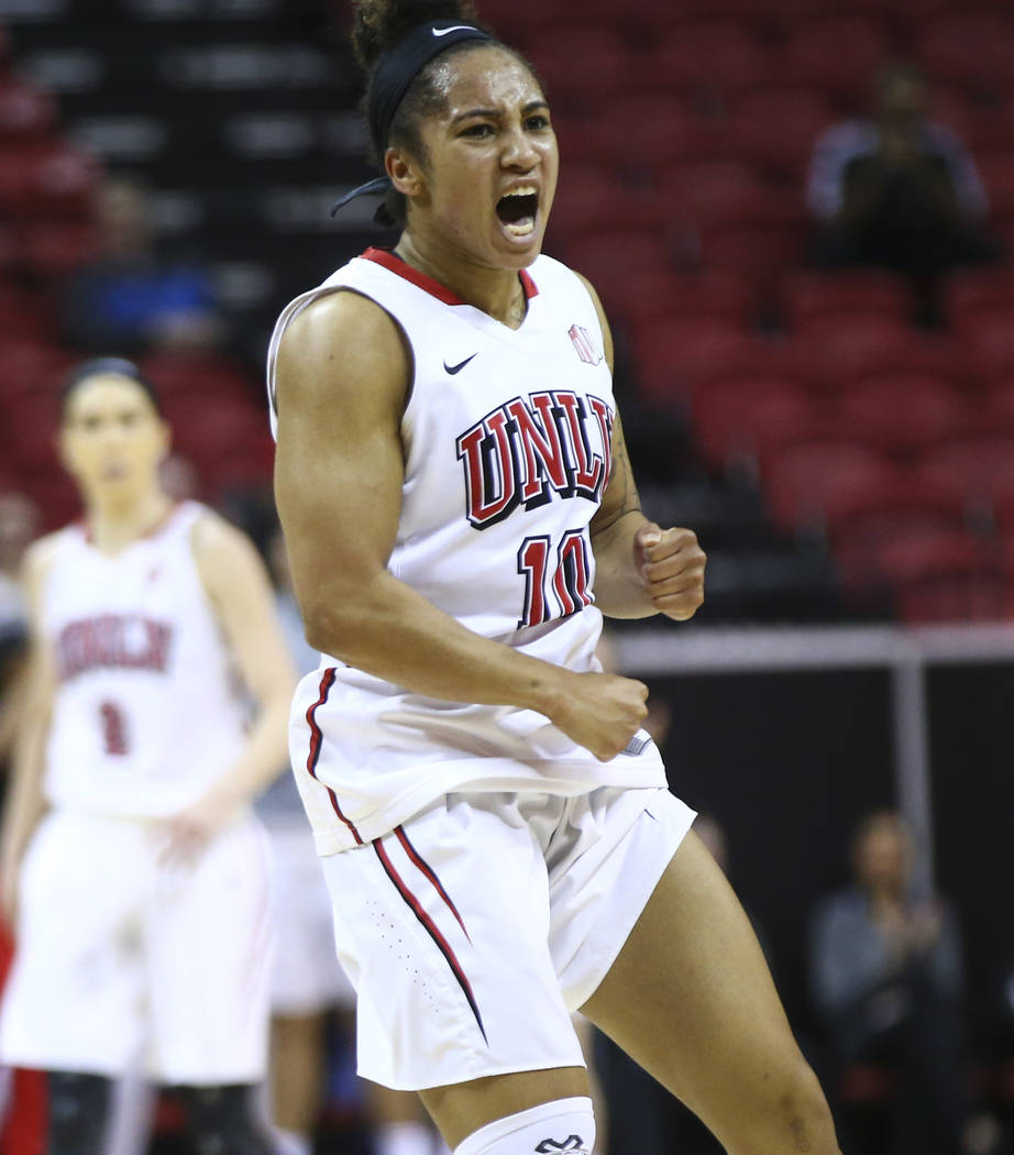 UNLV Lady Rebels guard Nikki Wheatley (10) celebrates after scoring against the UNR Wolf Pack during the first half of a basketball game in the Mountain West tournament quarterfinals at the Thomas ...