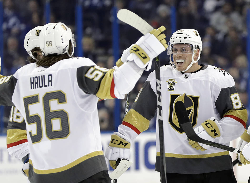 Vegas Golden Knights defenseman Nate Schmidt (88) celebrates with left wing Erik Haula (56) after scoring against the Tampa Bay Lightning during the first period of an NHL hockey game Thursday, Ja ...