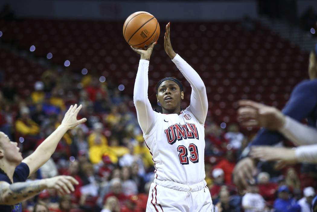 UNLV Lady Rebels forward Jordyn Bell (23) shoots against the UNR Wolf Pack during the first half of a basketball game in the Mountain West tournament quarterfinals at the Thomas & Mack Center  ...