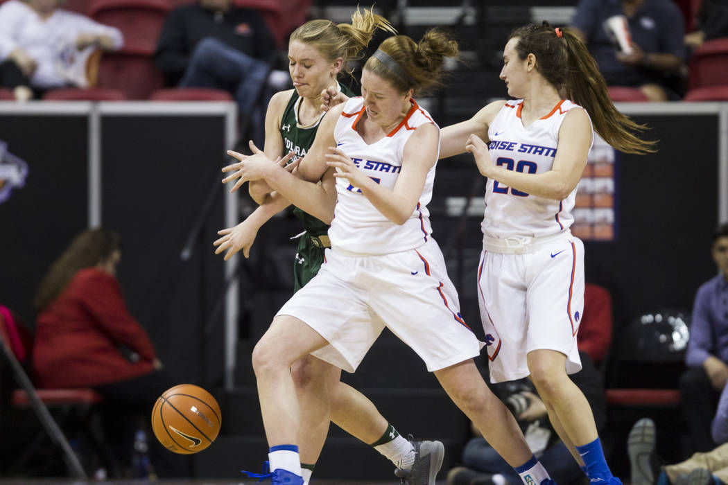 Colorado State Rams forward Annie Brady (32) fights for a loose ball with Boise State Broncos forward Tess Amundsen (15) and guard Marta Hermida (20) in the first half of the Mountain West Confere ...