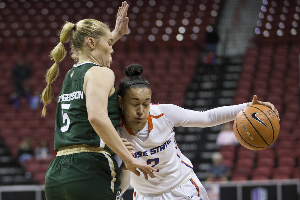 Boise State Broncos forward Shalen Shaw (2) drives to the basket under pressure from Colorado State Rams guard Sofie Tryggedsson (5) in the first half of the Mountain West Conference women's baske ...