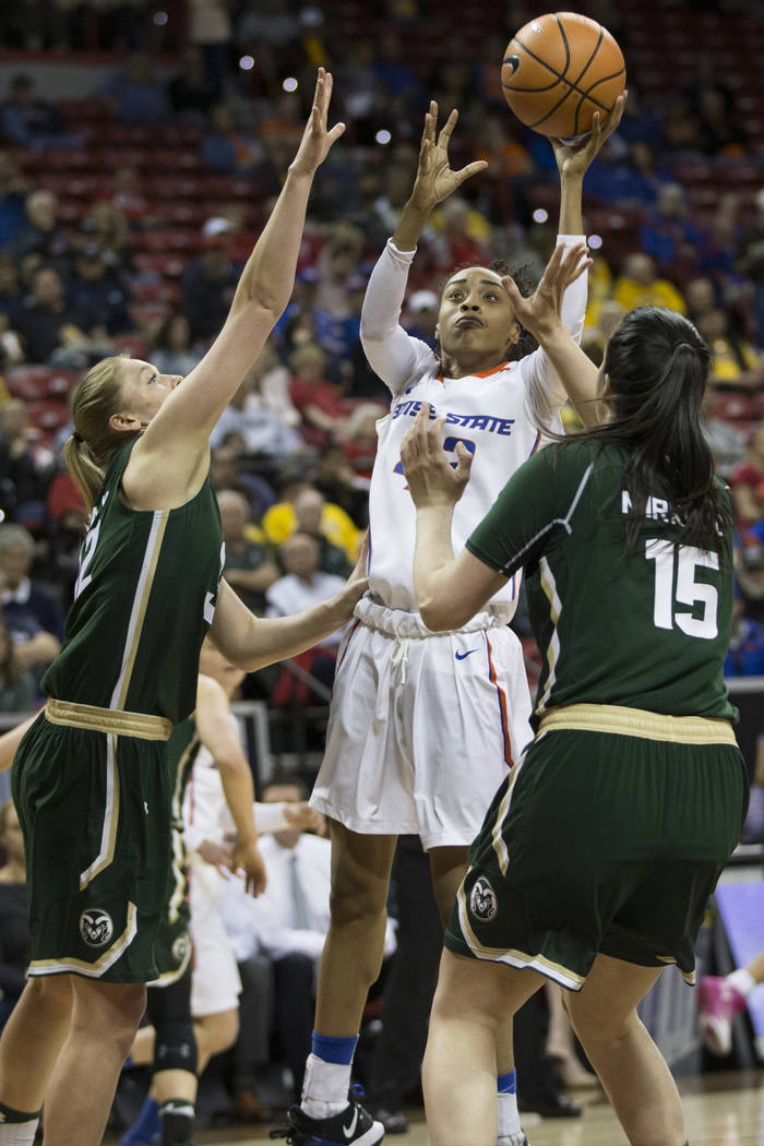 Boise State Broncos forward A'Shanti Coleman (42) takes a shot under pressure from Colorado State Rams forward Annie Brady (32) and forward Veronika Mirkovic (15) in the first half of the Mountain ...