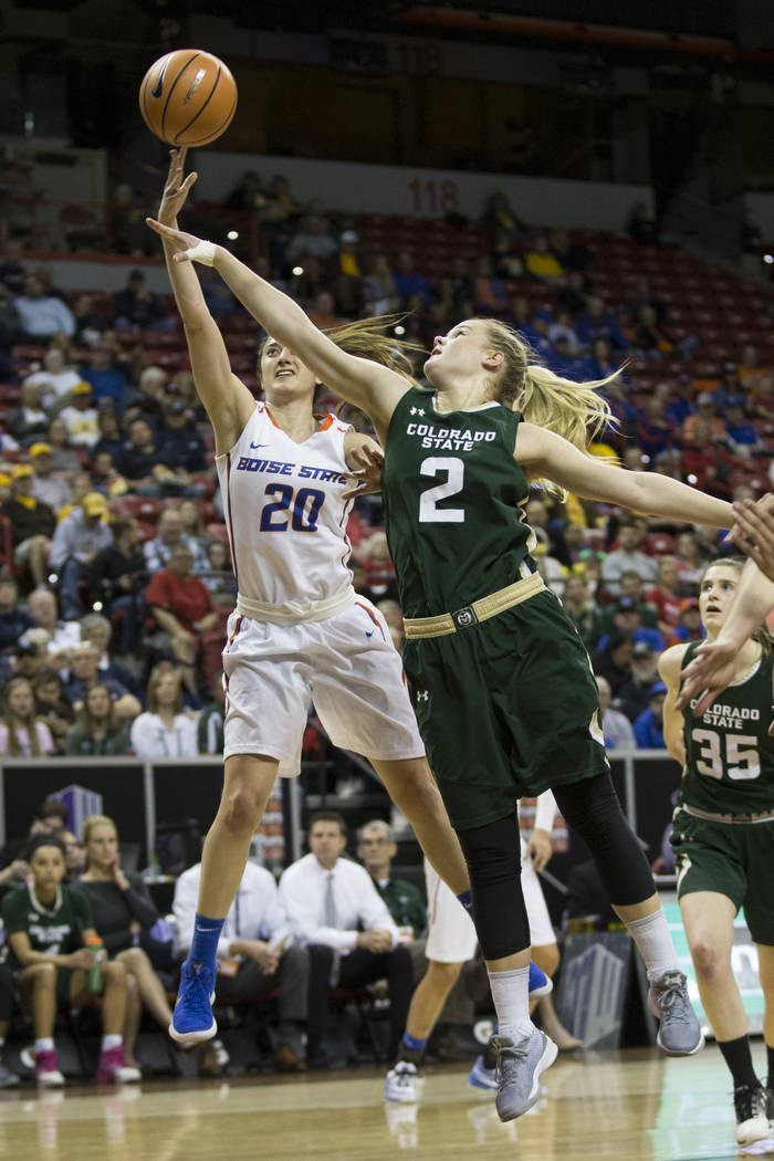 Boise State Broncos guard Marta Hermida (20) takes a shot against pressure from Colorado State Rams guard Stine Austgulen (2) in the first half of the Mountain West Conference women's basketball t ...